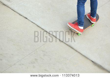 one young skateboarder legs skateboarding at skatepark
