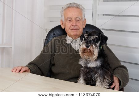 Old Man With Black Miniature Schnauzer Dog