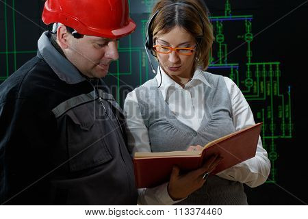 Woman Is Giving Instructions To Worker With Red Helmet In Power Plant