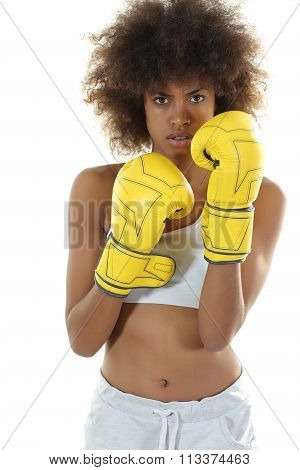 young black woman boxing yellow gloves