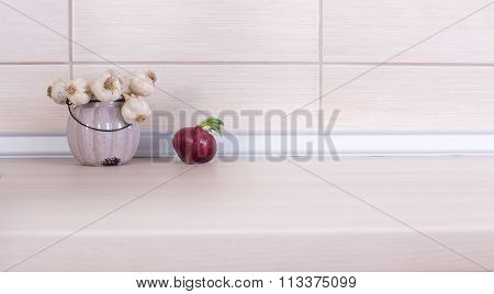Garlic And Onion On Countertop