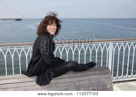 Brunette Woman At The Sunny Autumn Day Relaxing On Coast Feeling Good