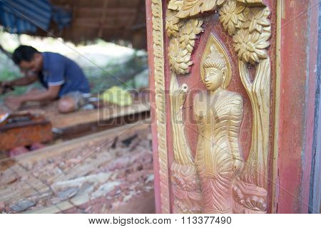 Traditional Craftsman Carving Wood With Buddha Image
