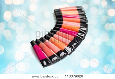 close up of lip gloss tubes over blue lights