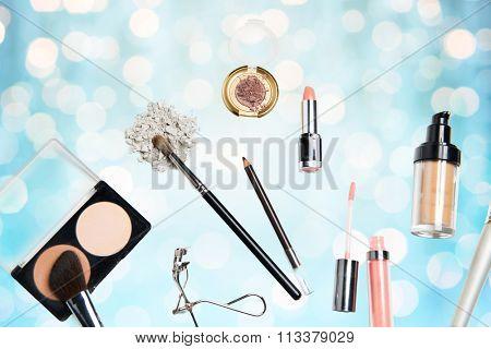 close up of makeup stuff over blue lights