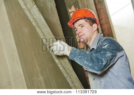 Plasterer at work with wall