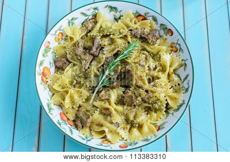 Pasta Farfalle With Turkey, Pesto nd Rosemary In Serving Plate Over Wooden Turquoise Background