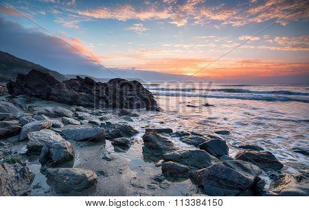 Beautiful Sunrise Over A Rocky Beach