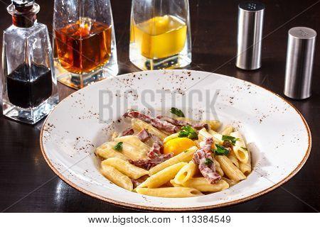 Pasta Carbonara With Chicken Egg Yolk And Parsley.