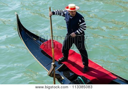 Gondolier On Gondola In Venice Italy