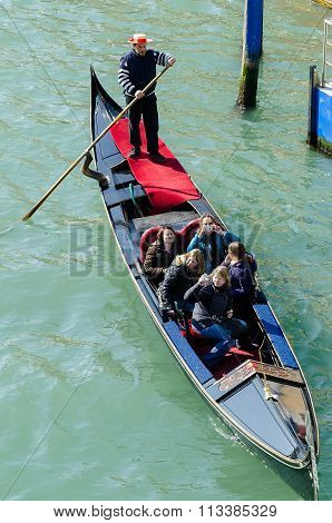 Tourists Travel On Gondolas At Canal  In Venice Italy