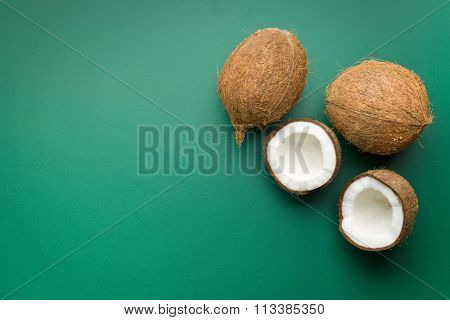 halved and whole coconut on chalkboard