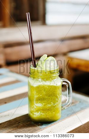 Iced Matcha Green Tea Lime Frappe On The Table Wood