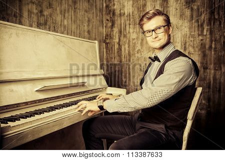 Pianist plays the piano. Art, musical concept. Toned photo, sepia.