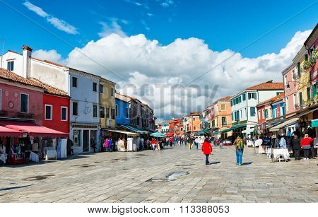 VENICE - AUGUST 27: Busy shopping street in famous Burano with its colorful houses in Burano, Venice, Italy on August 27, 2015.
