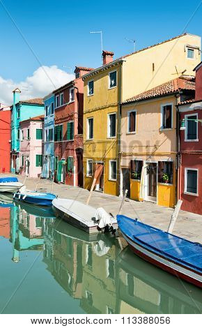 VENICE - AUGUST 27: Street scene in famous Burano with its colorful houses. Burano, Venice, Italy on August 27, 2015.