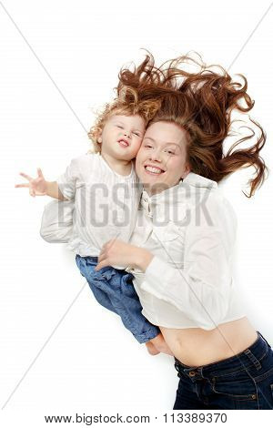 Girl lying oback with the baby cuddling