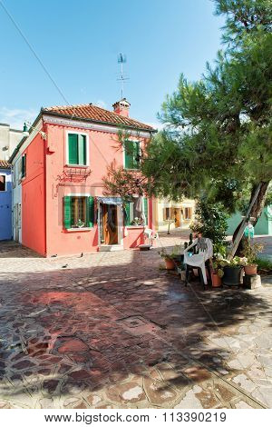 Street scene in famous Burano with its colorful houses near Venice, Italy