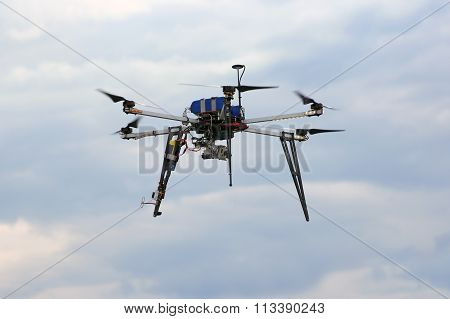 Flying  Drone In The Sky With Mounted  Digital Camera