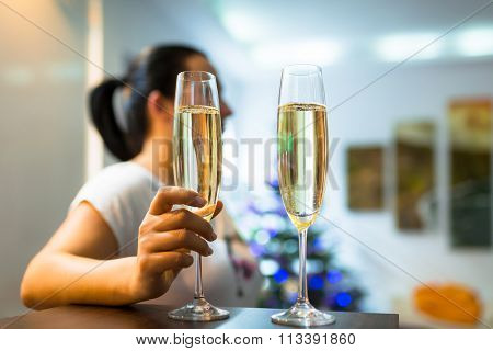 Woman on the date with flutes of champagne
