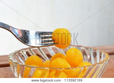 gold egg yolk drop Thai sweet in fork