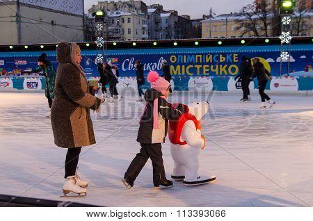 Kiev/Ukraine - January 2016: A small girl is doing her first skating steps.January 03, Kiev, Ukraine