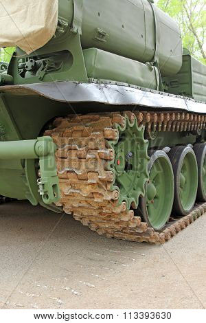 Part Of The Undercarriage Of Tracked Military Equipment, Close-up