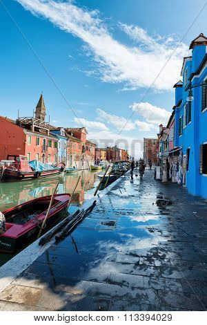 VENICE - AUGUST 27: Street scene with a canal and moored boats in Burano, Venice, Italy on August 27, 2015.
