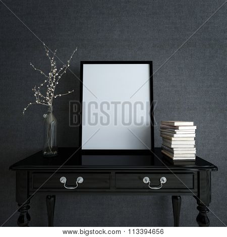 Modern Home Decor Detail with Copy Space - Blank Picture Frame on top of Painted Black Desk with Stack of Books and Flower Vase in Room with Dark Gray Wall