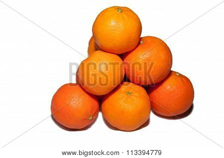 Pyramid Of Ripe Tangerines Isolated On White