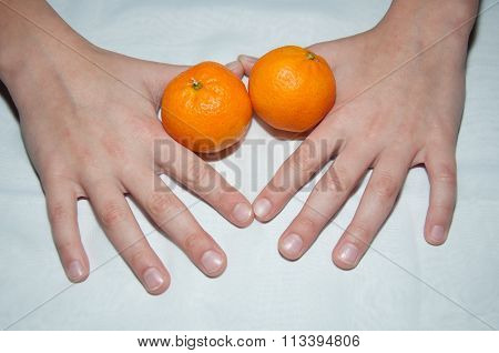 Mandarin Citrus Tangerine And Hands On The Table