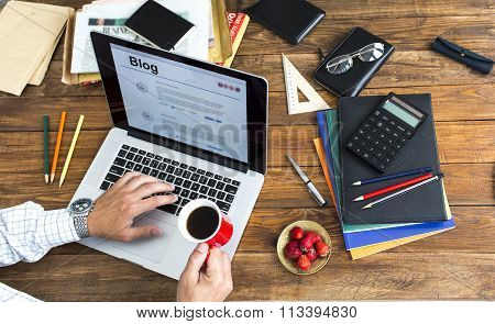 Blogger working at wooden desk