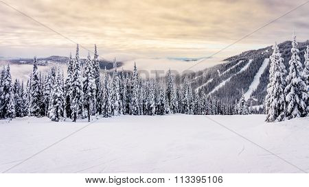 Sunrise over the ski runs at the Sun Peaks Ski Resort