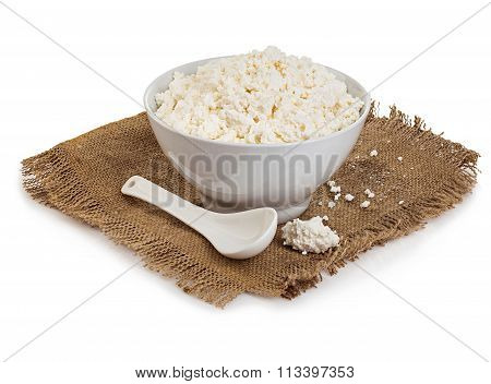 Traditional Fresh Cottage Cheese On Vintage Burlap Close-up On A White Background.