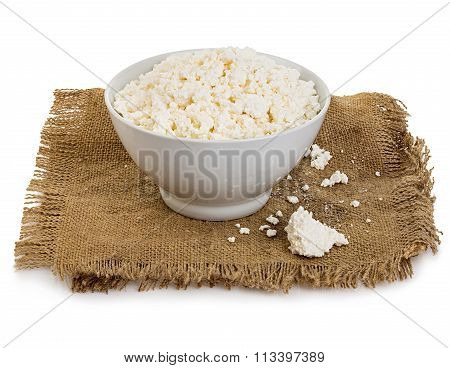 Traditional Fresh Cottage Cheese In Plate On Vintage Burlap Close-up On A White Background.