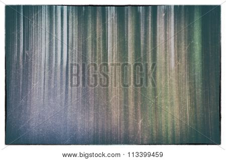 A Conceptual Photo Using Slow Shutter Speed Of Trees In A Forest Showing Green, Orange Leaves And La