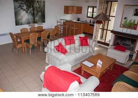 Contemporary Living Room With A Dining Area And Kitchen