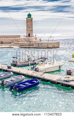 Beautiful Lighthouse And Boats In Cassis,france