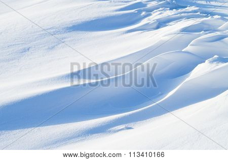 Fresh snow shaped by wind