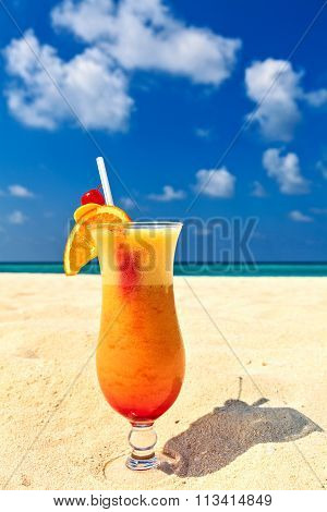 Glass Of Cocktail Is On Sandy Coral  Beach