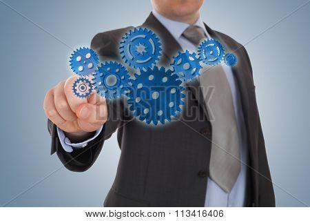 businessman indicate a cog gear