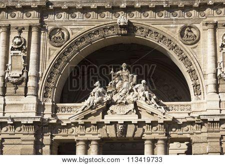 Statues On The Doorway Of Italian Cort