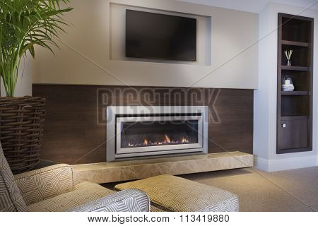 Cozy Armchair In Front Of A Fireplace