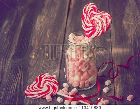 Heart Shaped Lollipops And The Jar With Marshmallows For Valentine's Day