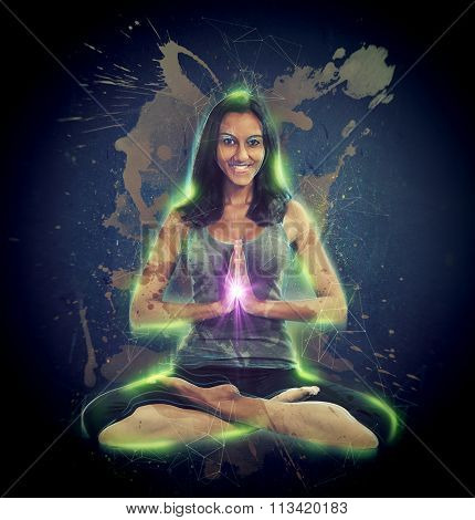 Full Length Portrait of Young Smiling Brunette Woman Practicing Yoga and Glowing, Sitting in Lotus Position with Hands Clasped with Spiritual Purple Light