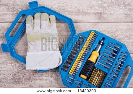 Steel Toolset And Working Glove On A Wooden Table And Working Glove On A Wooden Table