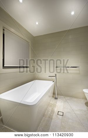 A Modern Tub In A Minimalistic Bathroom