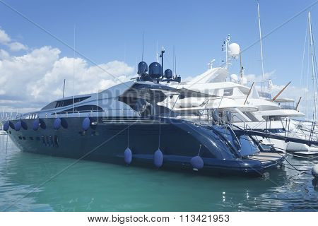 luxury super yachts anchored in Cannes harbor