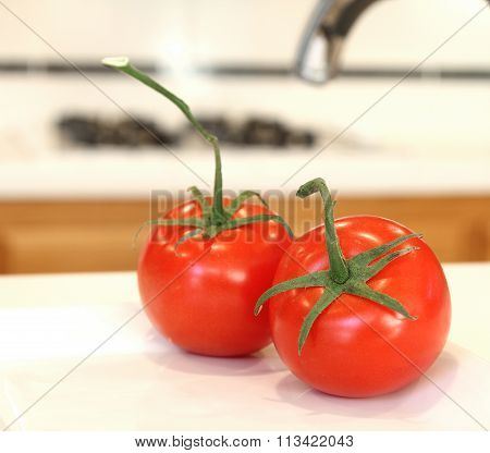 Tomatoes in a clean white kitchen.