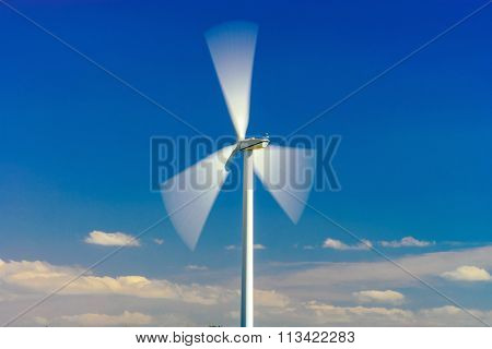 Wind Turbines Generating Electricity In Windfarm